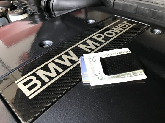Carbon Fiber Money Clip on BMW Engine