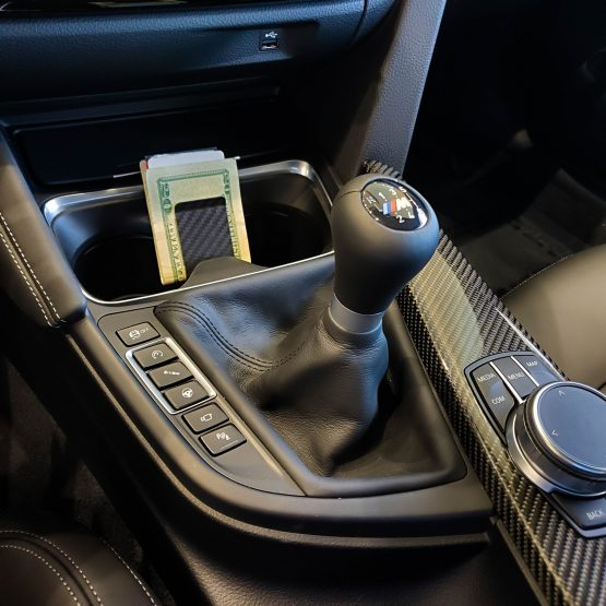 Carbon Fiber Money Clip in BMW Cup Holder